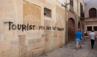 spain-tourism-sign-tourist-are-the-terrorist-705870
